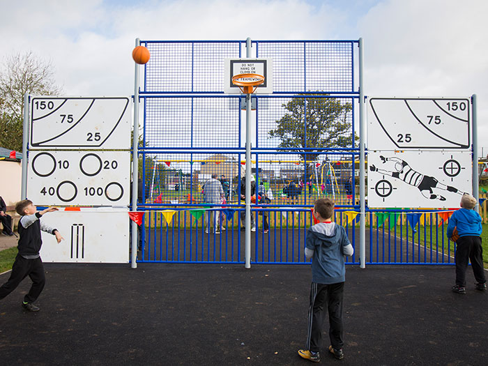 children playing ball games with the MUGA accessories such as the skills panels