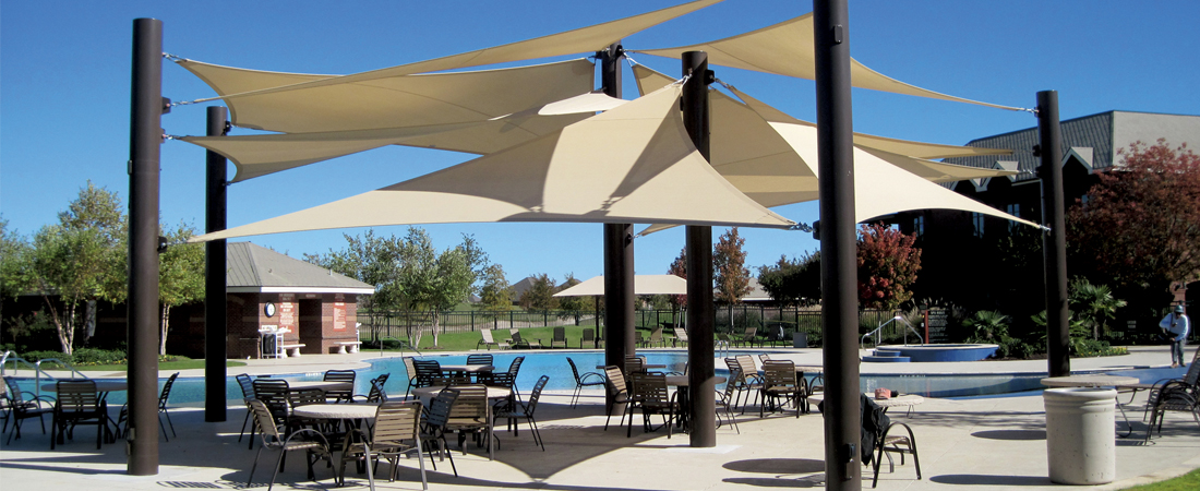 Fabric shade structures on outdoor seating area